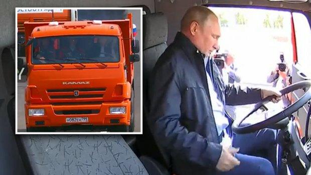 Путин му го покажа на светот руското чудо: Претседателот седна во камион и прв возеше по новиот мост (ВИДЕО)