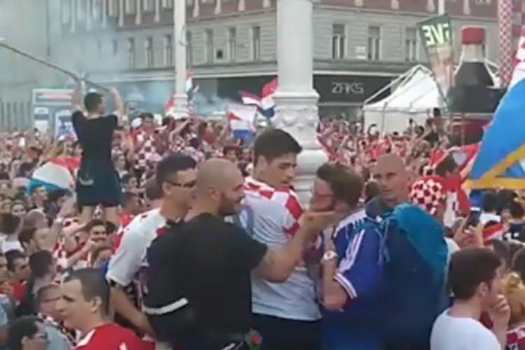 Провокатор во Загреб: Се појави во дрес на Франција сред толпа, па доби еден жежок шамар и уште неколку удари (ВИДЕО)