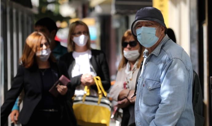 Усвоен законот: Задолжително носење маска на отворено и забрана за групирање на отворено