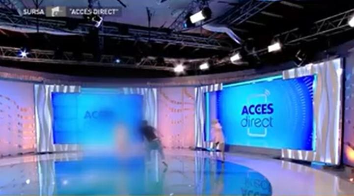 Драма на емисија во живо: Гола жена фрли цигла кон водителката (ВИДЕО)